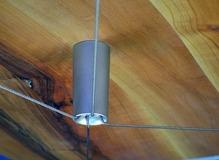 Sistema tendicavo a croce per piani tavolo
