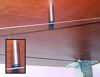 Amortisseur de vibrations pour le système de tendeur à câble