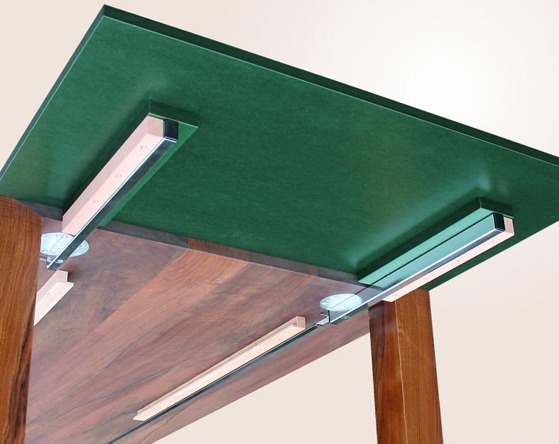 Coulisses pivotantes pour plateaux de table