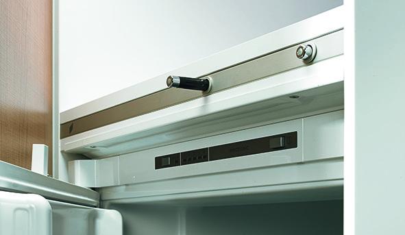 Système d'ouverture sans poignées pour réfrigérateurs HETTICH Easys